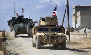 US forces patrol the outskirts of the Syrian town of Manbij.