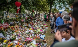 People view tributes left in Christchurch, New Zealand, after the mosque shootings. The Australian man accused of killing 51 worshippers, has changed his plea to guilty.