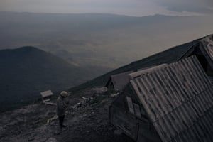 A ranger stands at the campsite at the top of the volcano