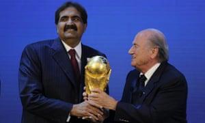 Sheikh Hamad bin Khalifa Al-Thani receives the World Cup trophy from Sepp Blatter