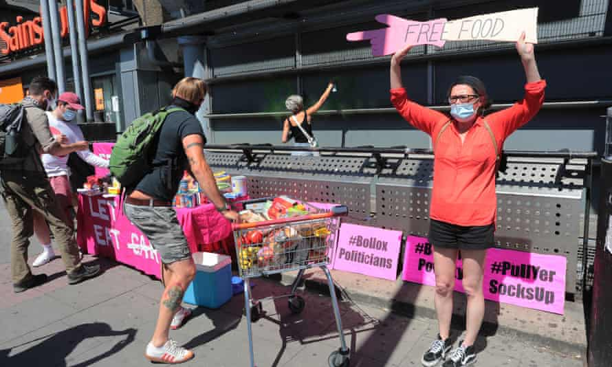 Beyond Politics activists distribute food outside Sainsbury's in Camden Town, London.