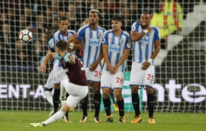 Aaron Cresswell gets a free-kick all wrong and the ball curls harmlessly over the bar.