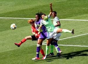Ebi and Nnadozie battle in defence.
