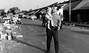 Arnold Wesker with his daughter in an East End market, 1962.