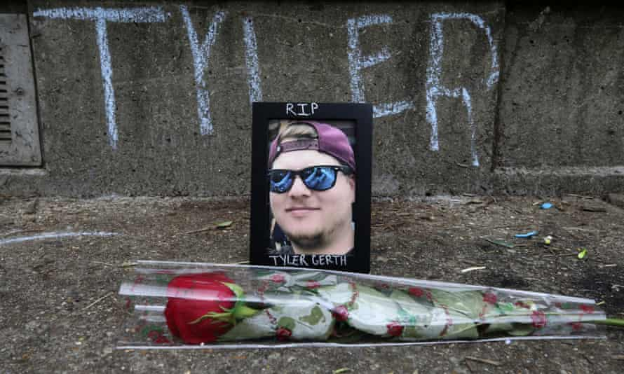 A makeshift memorial dedicated to Tyler Gerth, a photographer who was shot and killed at a protest in Louisville.