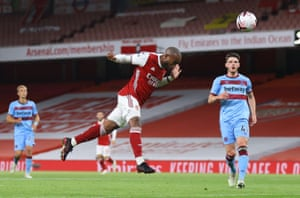 Arsenal's Alexandre Lacazette heads in the opening goal.
