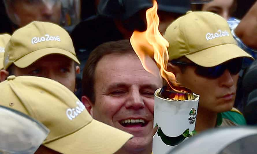 Eduardo Paes, the Rio mayor, carries the Olympic torch.