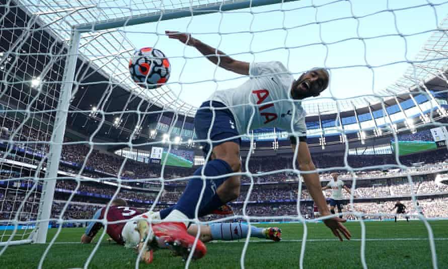Lucas Moura celebrates Tottenham's second and winning goal after Matt Targett put through his own net.