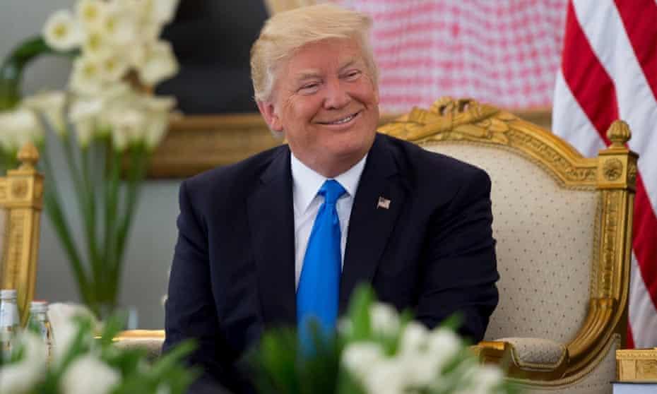 Donald Trump smiles after being welcomed by Saudi Arabia's King Salman bin Abdulaziz Al Saud in Riyadh.