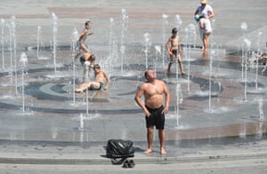 Kiev, UkraineA man refreshes himself in the fountains in the city centre during the heatwave.