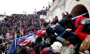 Pro-Trump protesters storm into the US Capitol on 6 January.