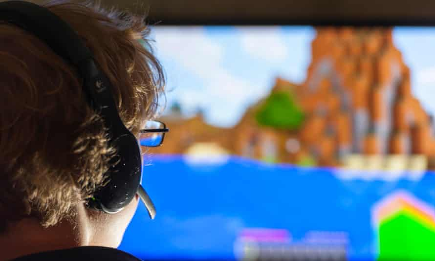 A boy plays Minecraft, developed by Swedish company Mojang.
