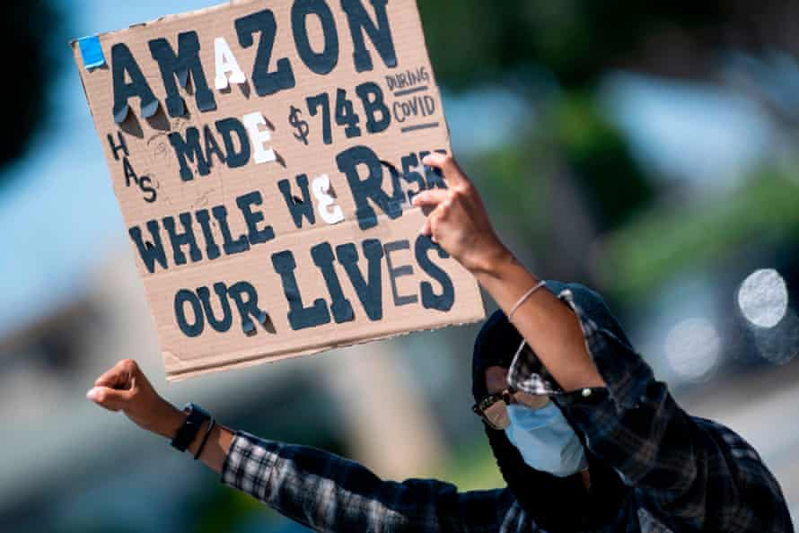 Workers protest against the failure from their employers to provide adequate protections in the workplace of the Amazon delivery hub in Hawthorne, California, on 1 May.