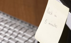 Sticky note with 'Back in five minutes' written on it on computer monitor