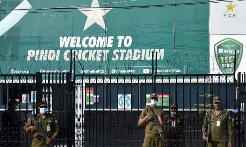 Police officers stand guard outside Rawalpindi Cricket Stadium after New Zealand pulled out of their tour.