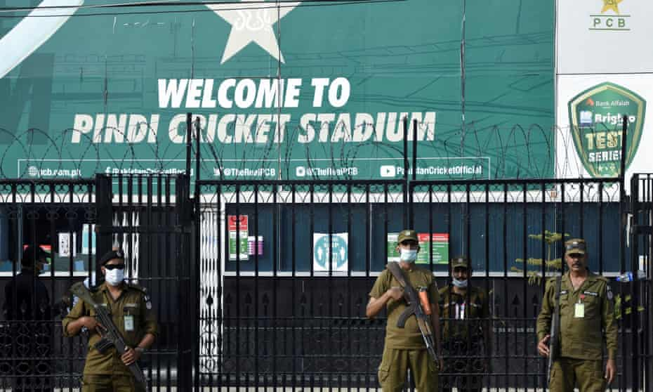 Police officers stand guard outside Rawalpindi Cricket Stadium after New Zealand pulled out of their Pakistan tour.