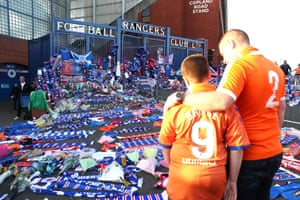Fans observe the floral tributes outside the stadium for former Rangers player Fernando Ricksen before the match against Feyenoord.