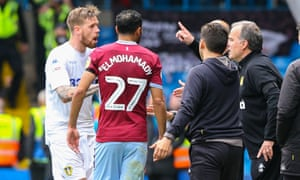 Leeds United manager Marcelo Bielsa gives Pontus Jansson instructions after his side scored a contentious goal against Aston Villa.