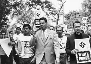 Rockwell, pipe in hand, leads a group of his supporters in 1967.