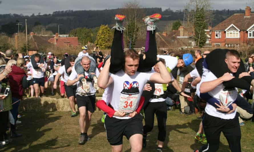 """the 2015 UK """"wife""""-carrying race in Dorking."""