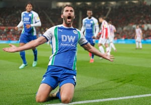 Will Grigg of Wigan Athletic celebrates scoring the penalty.