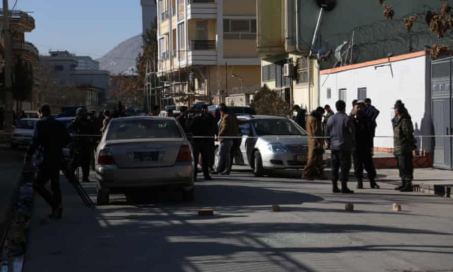 Afghan security force members inspect the site of the attack on two female judges in Kabul.