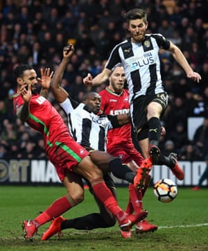 Shaun Brisley and Foluwashola Ameobi of Notts County get past the Swansea City defence during the 1-1 draw at Meadow Lane.