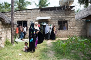 People wait in line outside the clinic on Pate island