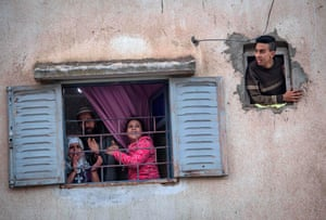 Rabat, Morocco Residents confined at home thank the authorities from their windows as security forces and health workers instruct people to return to and remain at home as a measure against Covid-19
