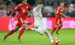 James Milner clears the ball away as Bayern Munich midfielder Serge Gnabry closes him down.