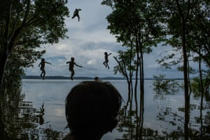 Daily Life, second prize, singles - Mauricia Lima - Indigenous children jump into the water as they play around the Tapajós river in Brazil, in the Munduruku tribal area called Sawré Muybu