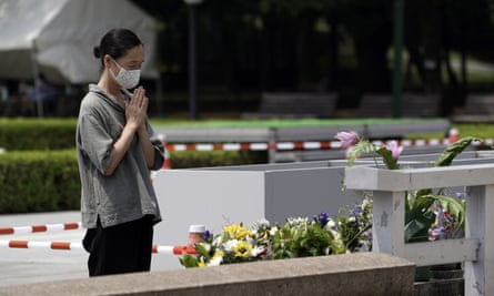 A woman prays in front of the cenotaph for the atomic bombing victims in Hiroshima on Monday.
