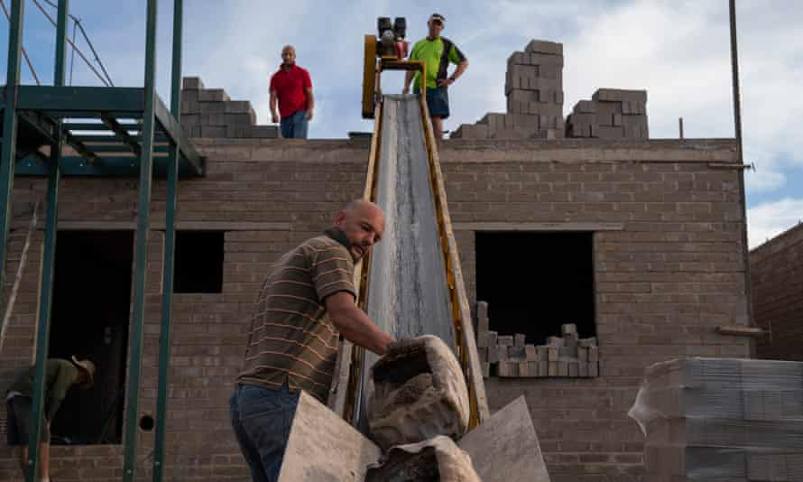 White Afrikaner Oranians build homes to house the hoped-for population boom.