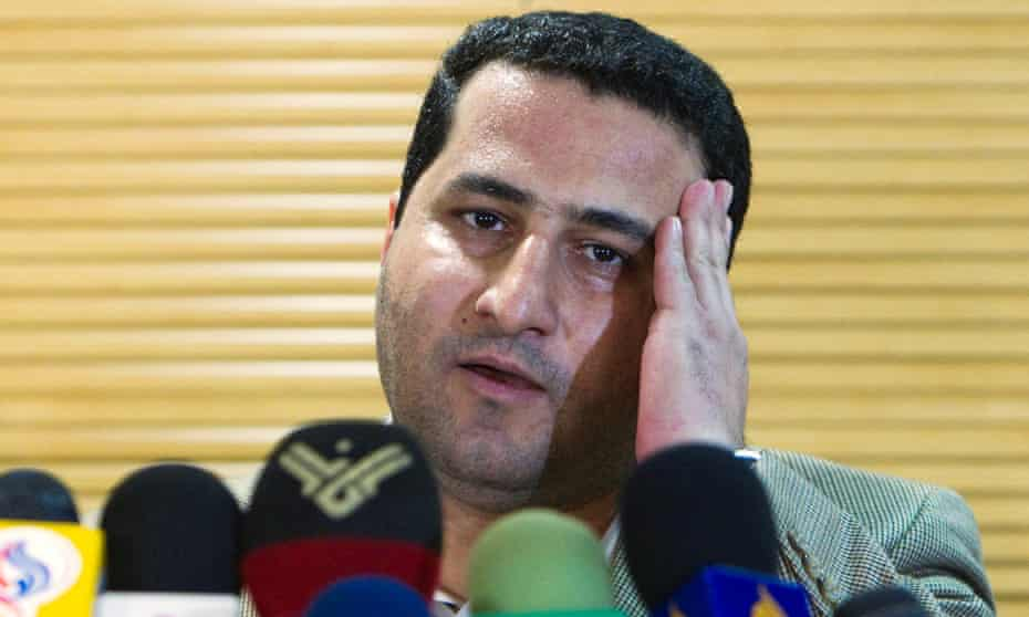 Shahram Amiri speaks to journalists after returning to Tehran in July 2010