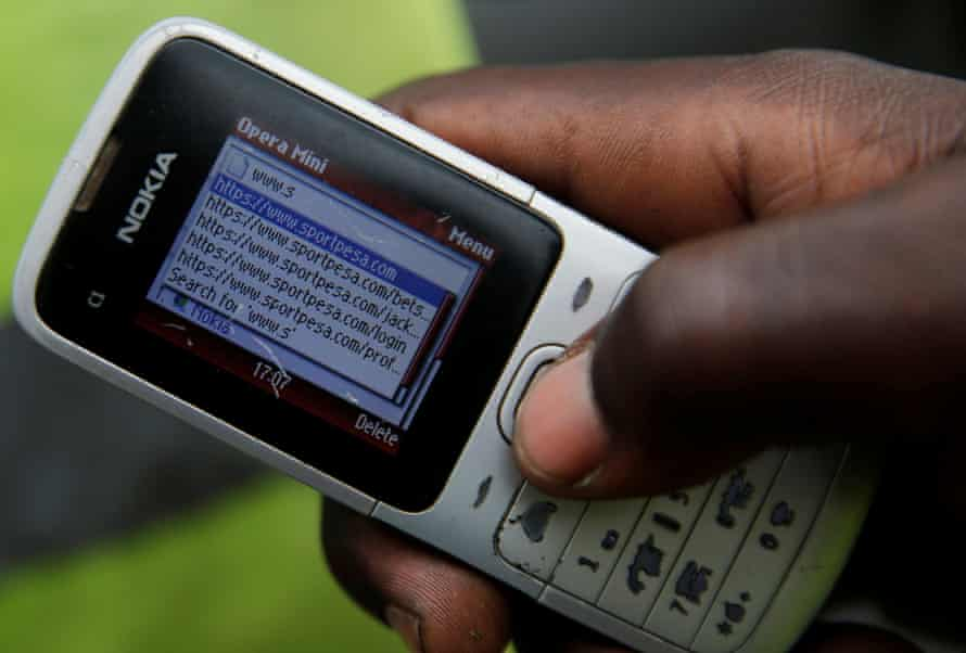 A gambler in Nairobi uses his phone to access SportPesa's website.