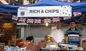 Richard Bampfylde, left, at his Rich & Chips stall in Beirut.