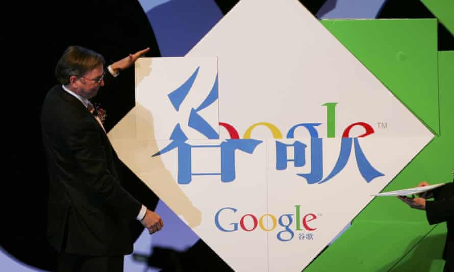 Google's chief executive, Eric Schmidt, spells Chinese characters 'Gu Ge' at the inauguration of the company new Chinese brand name in Beijing in 2006.
