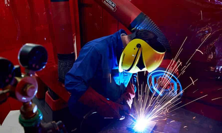 A welder works in a factory