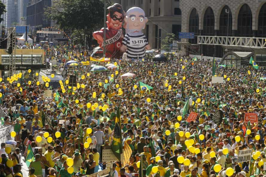 Demonstrators demanding the impeachment of Brazil's president Dilma Rousseff march during a protest.