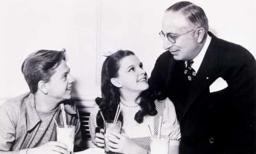 Actors Mickey Rooney and Judy Garland with Louis B Mayer. Mayer insisted his young protege sit on his lap.