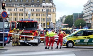 Police and rescuers at the scene in Turku after multiple stabbings.