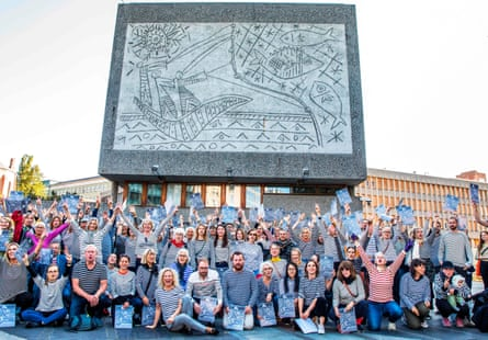 Protesters wearing striped sweaters in honour of Picasso demonstrate in front of the Fishermen mural in 2019.