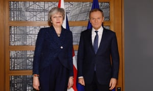 British Prime Minister Theresa May (L) and President of the European Council Donald Tusk (R) pose for a photo ahead of their meeting in Brussels, Belgium on February 07, 201