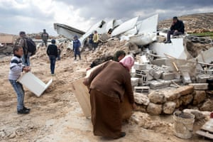 Villagers in Khirbet Jenbah rescue furniture following house demolitions by the Israeli military