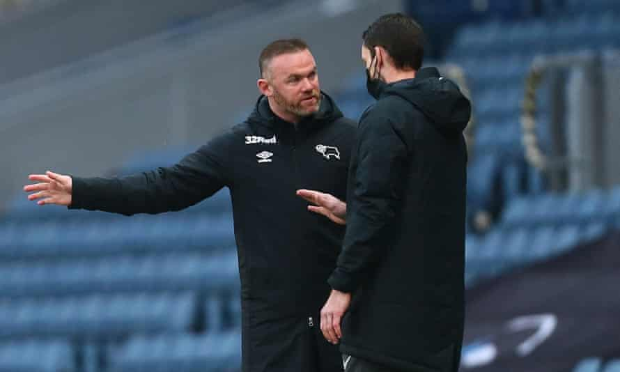 Wayne Rooney remonstrates with the fourth official following a denied penalty call late on at Blackburn