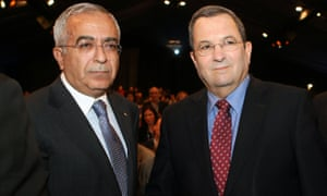 Palestinian prime minister Salam Fayyad (L) and then Israeli defence minister Ehud Barak shake hands at a conference on security and policy in Herzliya, north of Tel Aviv, on 2 February 2010.