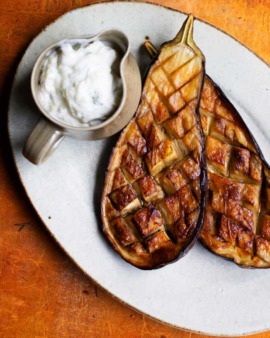 'The crisscross of slashes on the cut side is the way to get them cooked right through': baked aubergines with cucumber and basil sauce.