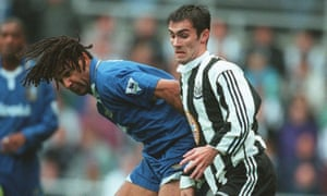 Keith Gillespie tussles for the ball with Ruud Gullit at St James' Park.