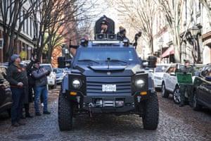 InfoWars host Alex Jones rides in an armoured vehicle