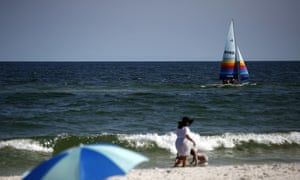 Beachgoers take to the Gulf shores for a long holiday weekend in Orange Beach, Alabama.
